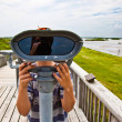 Boy watching the nature through a binocular — Stock Photo #5690015