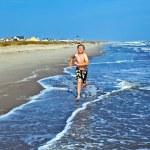 Boys enjoying the beautiful ocean and beach — Stock Photo #5690272