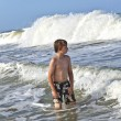 Boy enjoys the waves of the ocean — Stock Photo #5690439