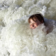 Child has fun in the waves — Stock Photo #5690469