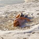 Boy lying at the beach and enjoying the sun — Stock Photo #5690553