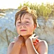 Young happy smiling boy at the beach — Stock Photo #5690614