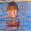 Child has fun in the outdoor pool — Stock Photo #5690761