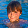 Child has fun in the outdoor pool — Stock Photo #5690774