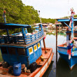 Colorfol Fisherboats in a small village - Stock Photo