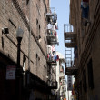 Iron fire escape is used for drying clothes downtown San Franzis — Stock Photo #5695398