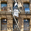 Iron fire escape is used for drying clothes — Stock Photo #5695501