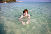 Boy swimming in the beautiful clear ocean — Stock Photo