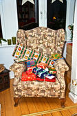 Christmas presents on an old chair for the celebration — Stock Photo