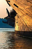 Aircraft carrier in sunset — Stock Photo