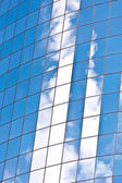 Facade of Skyscraper with reflection of sky — Stock Photo