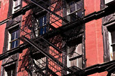 Fire ladder at old houses downtown in New York — Foto Stock