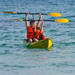 Father and son are padelling with a canoe on open sea — Stock Photo #5713801