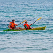 Father and son are padelling with a canoe on open sea — Stock Photo #5713853