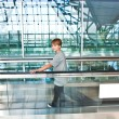 Boy in the departure hall  in the new Airport on a moving stairc — Stok fotoğraf