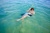 Young boy starts snorkeling in the clear sea — Stock Photo