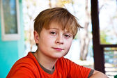 Boy with brown eyes is looking self confident and happy — Stock Photo