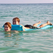 Stockfoto: Brothers enjoy playing together in teh crystal clear ocean