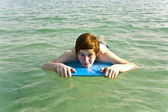 Boy surfing in the sea — Stock Photo