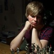 Boy is playing chess — Stock Photo