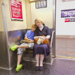 Child with mother sitting in the subway - Stock Photo