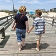 Stock Photo: Mother and son walking hand in hand
