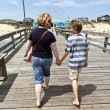 Mother and son walking hand in hand — Stock Photo