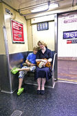 Child with mother sitting in the subway — Stok fotoğraf