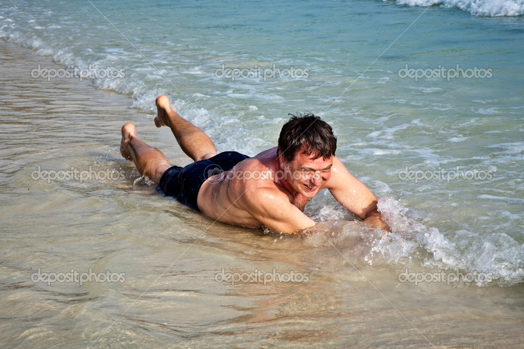 Фото: young woman is lying on the beach
