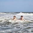 Boys enjoying the waves in the wild ocean — Stock Photo #5780114