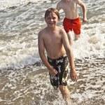 Boys enjoying the beautiful ocean and beach — Stock Photo #5780342