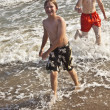 Boys enjoying the beautiful ocean and beach — Stock Photo #5780357