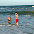 Brothers have fun at the beautiful neach of the ocean — Stock Photo #5780546
