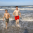 Brothers have fun at the beautiful neach of the ocean — Stock Photo #5780576