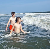 Boy enjoying the beautiful ocean and beach — Stock Photo