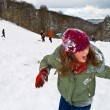 Children have a snowball fight in the white snowy area — Stock Photo