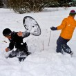 Royalty-Free Stock Photo: Children have a snowball fight in the snow area