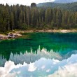 Perfectly clear emerald lake in the mountains - Stock Photo