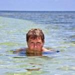 Swimming man inm the ocean — Stock Photo #5795680