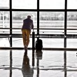 Man waiting for departure of his flight - Stock Photo