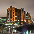 Speicherstadt at night in Hamburg - Stock Photo