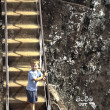 Boy climbs up the rocky stairs to the old fortress of Sigiria in - Stock Photo