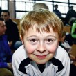 Young boy plays soccer and enjoys it - Zdjęcie stockowe