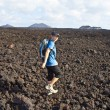 Boy on walking trail in volcanic area in Lanzarote — Stock Photo