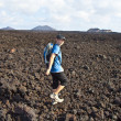 Boy on walking trail in volcanic area in Lanzarote - Stock Photo