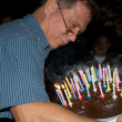 Man blows out his birthday candles at the birthday — Stock Photo #5797008
