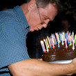 Man blows out his birthday candles at the birthday — Stock Photo #5797019