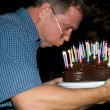 Man blows out his birthday candles at the birthday — Stock Photo #5797037