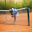 Boy has lost a tennis match and is sad about it — Stock Photo