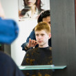 Smiling young boy with red hair at the hairdresser — Stock Photo #5797572